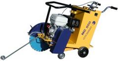 Bituminous concrete cutting machines