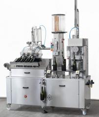 Foil machines for champagne bottling line