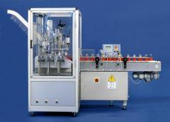 Automatic machine for filling and capping bottles