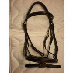 Articoli per equitazione: briglie e testiere
