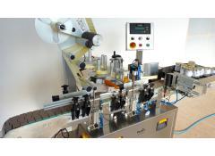 Linea di etichettatura automatica per prodotti rotondi